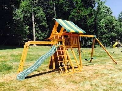 b2ap3_thumbnail_Cedar-Swing-Set-with-Striped-Tent-and-Monkey-Bars