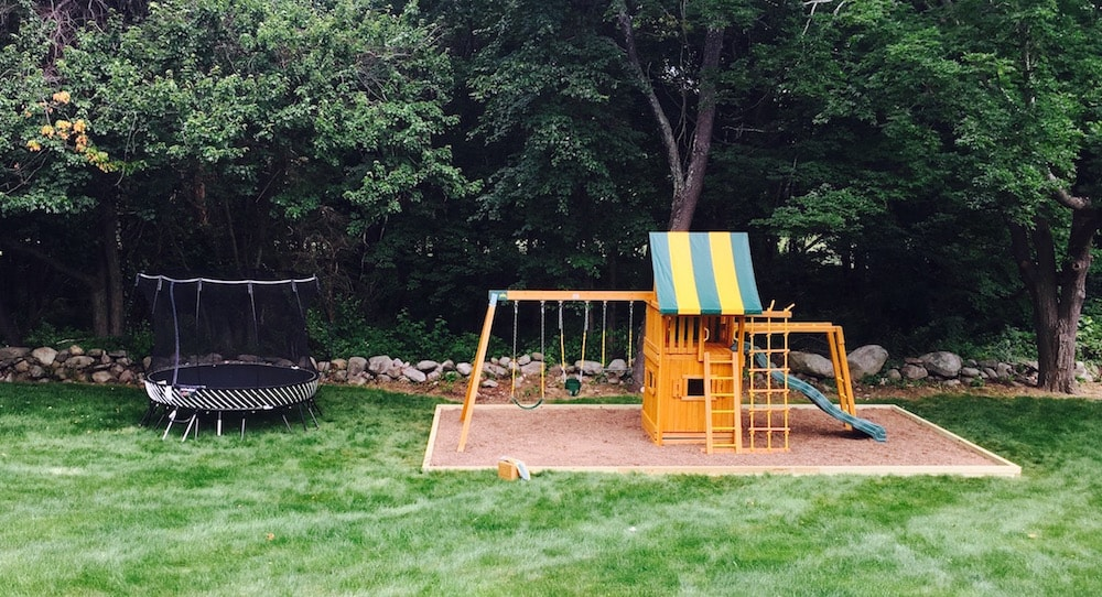 Wood Swing Set and Springfree Trampoline from Best in Backyards