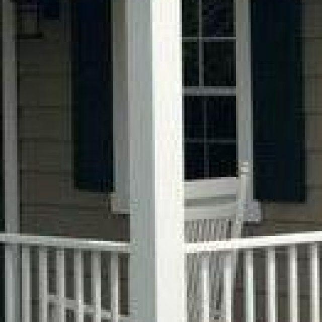white vinyl square post on pool house