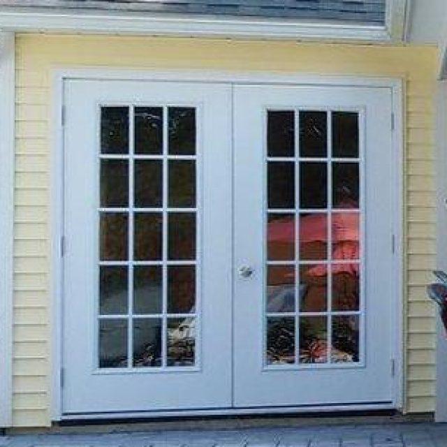 white vinyl double door for new outdoor pool house