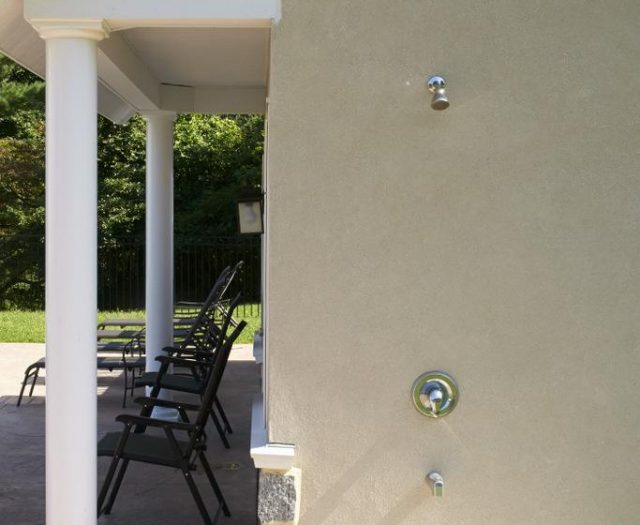 outdoor shower installation for pool house