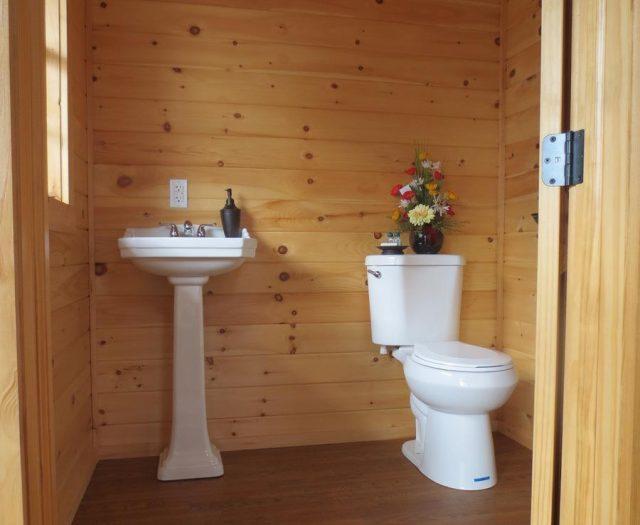 pool house bathroom with groove pine interior