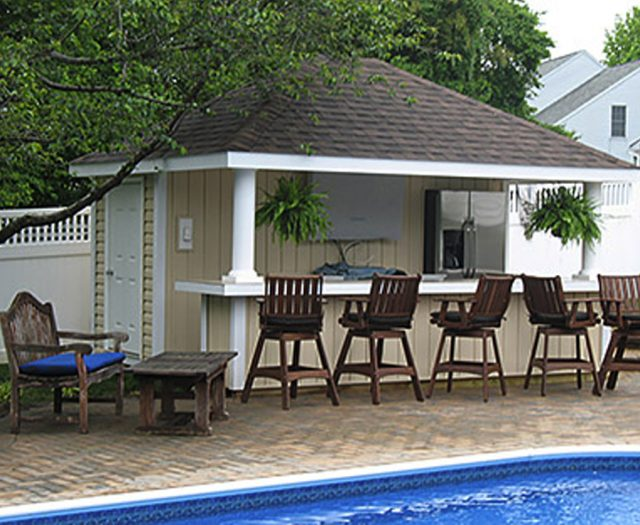 siesta pool house with covered seating area