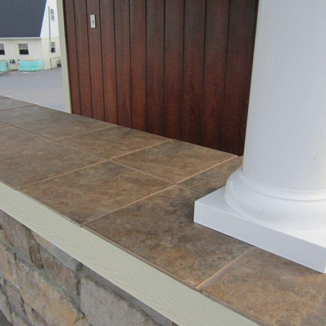 tile countertop installation in new pool house bar