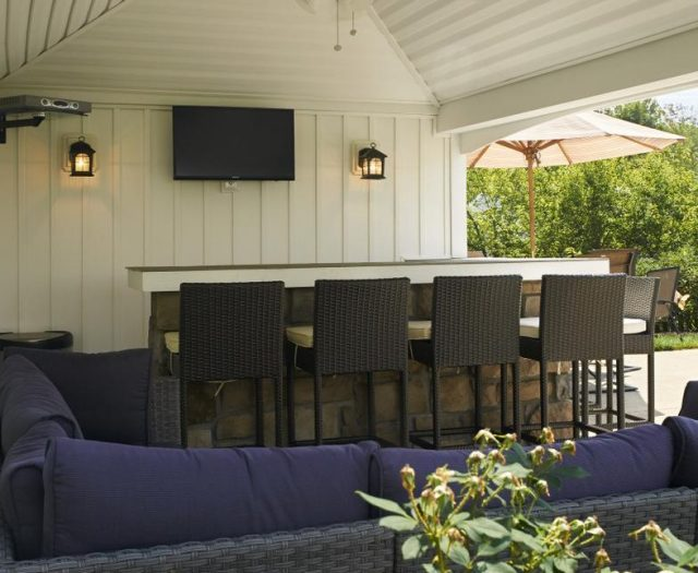 covered tv and outdoor living area