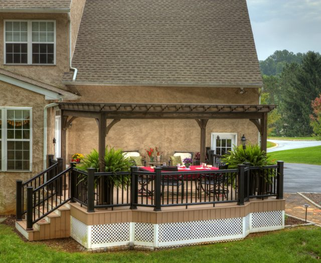 10 x 16 Tradition Wood Pergola in Cinder Stain on a Deck