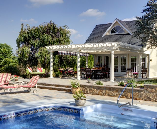 18' x 20' Artisan Ivory Vinyl Pergola with Tall Posts attached to Pool House