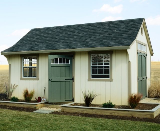 Backyard Cape Wooden Storage Shed with Large Windows and Landscaping