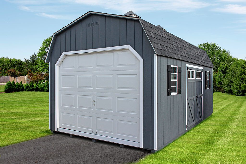 Dutch Barn in a Backyard with White Overhead Garage Door