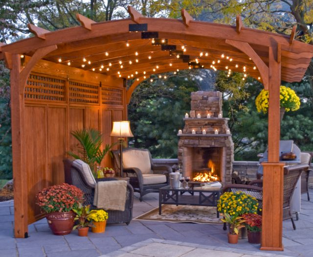 Hearthside Pergola on a Patio with Outdoor Fireplace Living Area