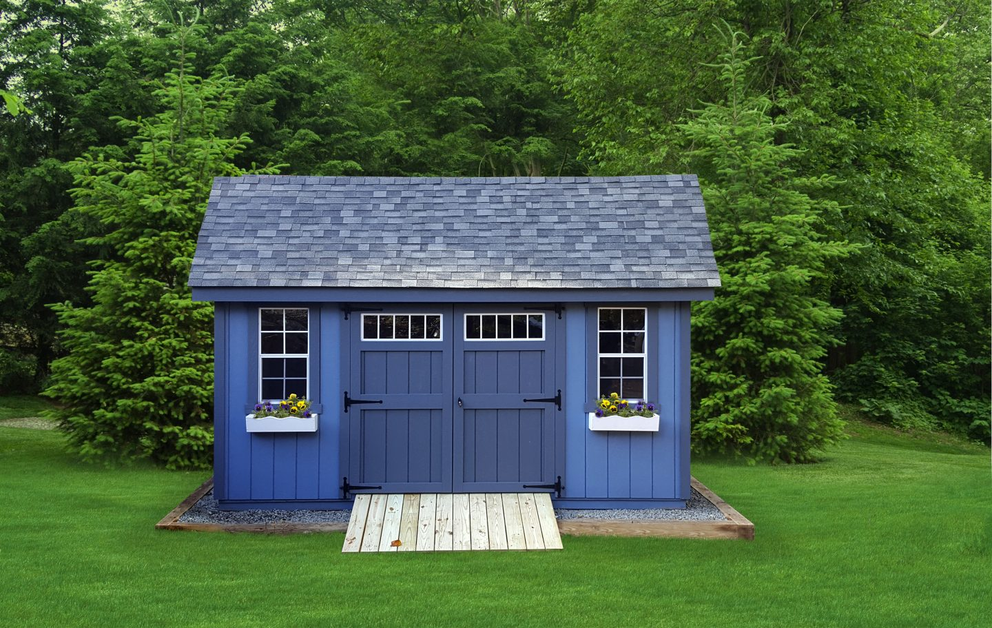 Large Blue Storage Shed with Large Doors Flower Boxes and Transom Windows