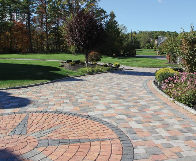 Nicolock Outdoor Patio Pavers with Design on Driveway