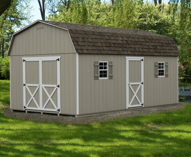 Outdoor Storage Shed Dutch Barn Style on a Gravel Bed with White Trim and Shutters