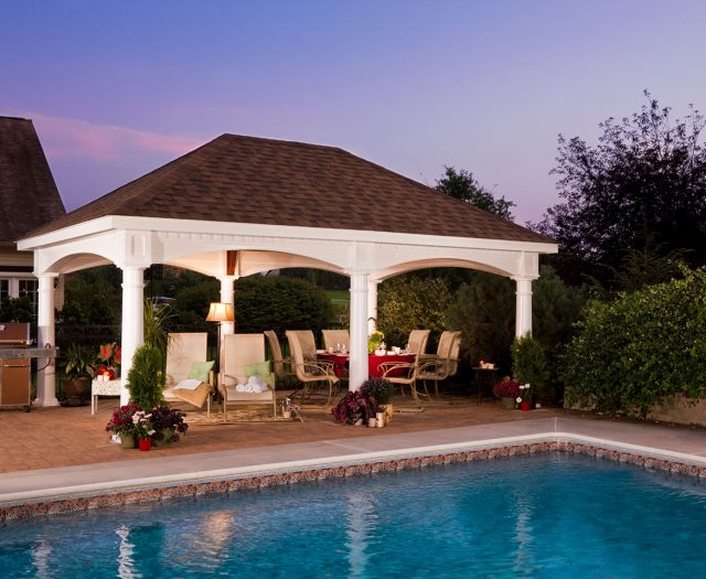 Outdoor Vinyl Pavilion at Night with Dining Chairs Poolside