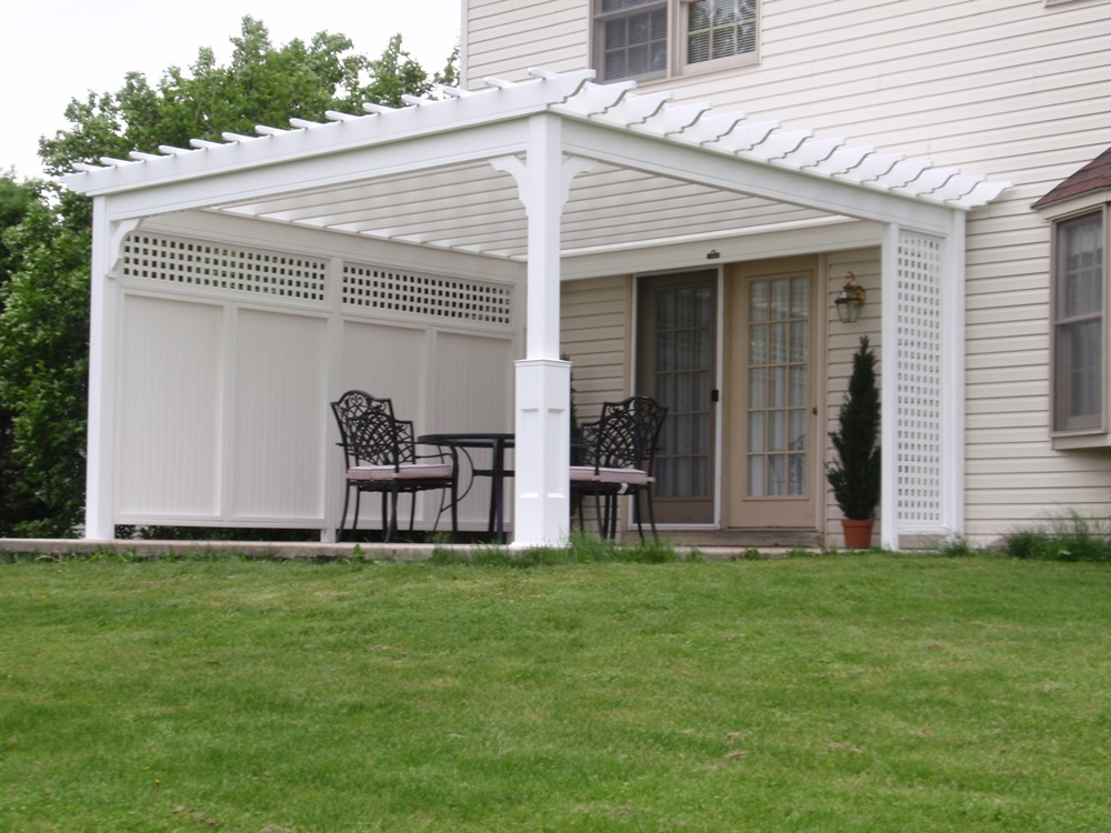Traditional Vinyl Pergola in White Vinyl with Privacy Wall 14x14