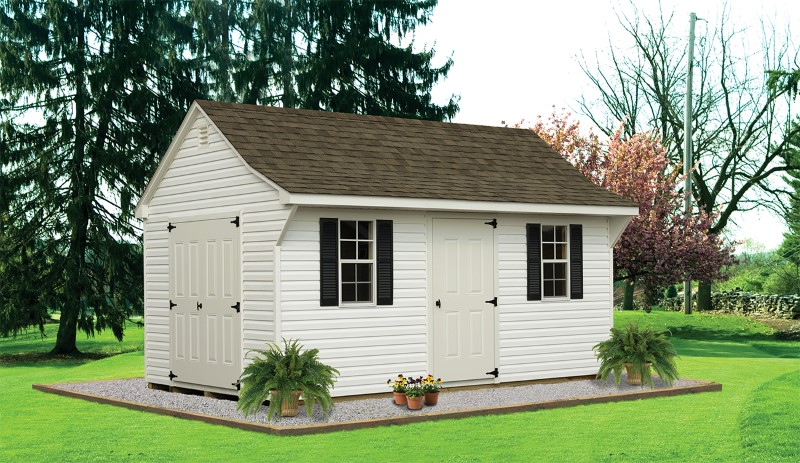 Vinyl Backyard Cape Storage Shed In White On A Gravel Bed In A Backyard