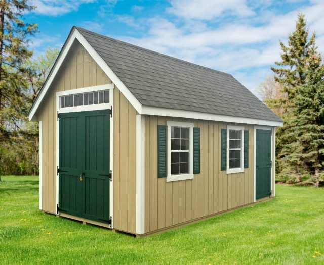 Wooden Tool Shed in a Backyard with Green Shutters Delivered and Installed