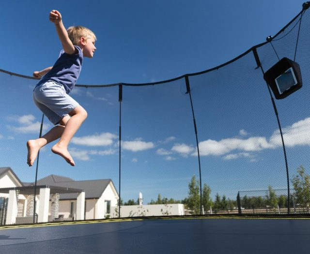 boy jumping on trampoline with tgoma gaming system