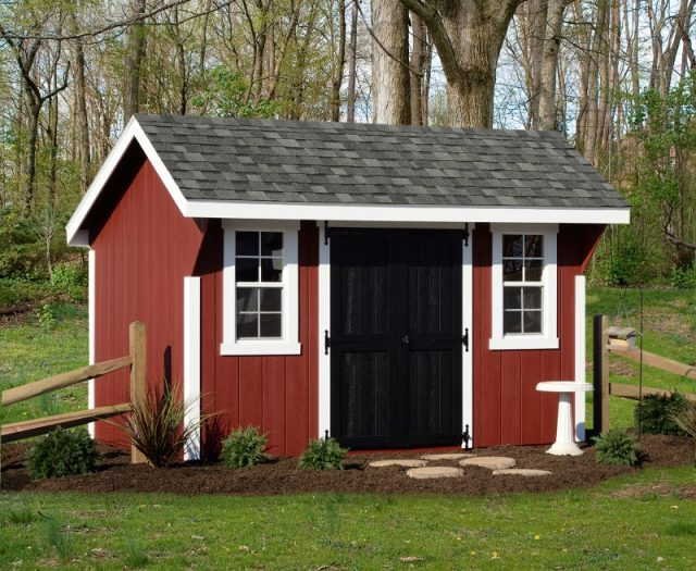 Eilte Quaker Storage Shed with Landscaping and White Trim around the Windows