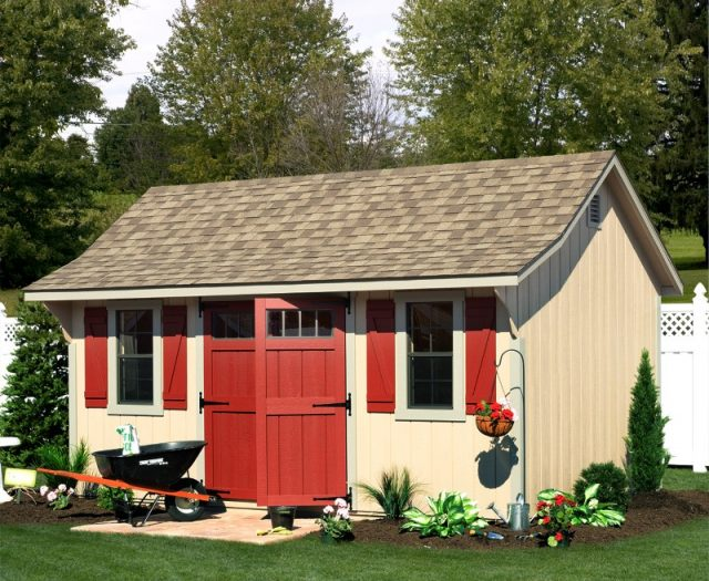 Elite Cape Wood with Red Doors and Red Shutters in a Garden Setting