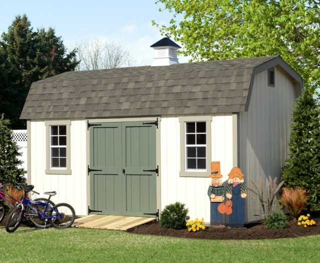 Elite Wood Dutch Barn with Green Double Doors a Cupola and Wooden Ramp