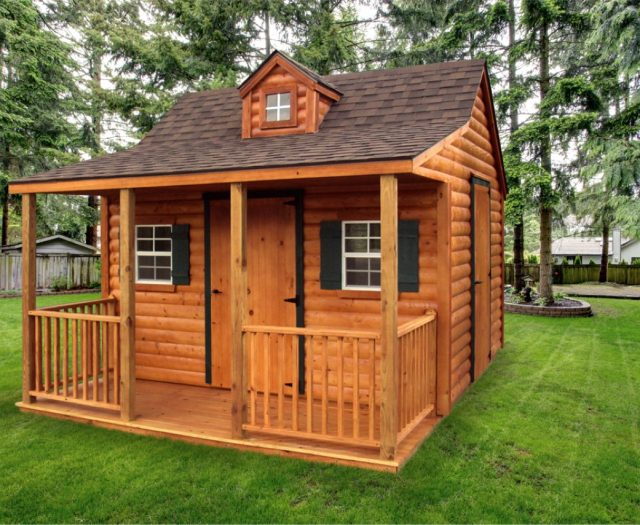 wooden kids playhouse cottage with attached porch and windows