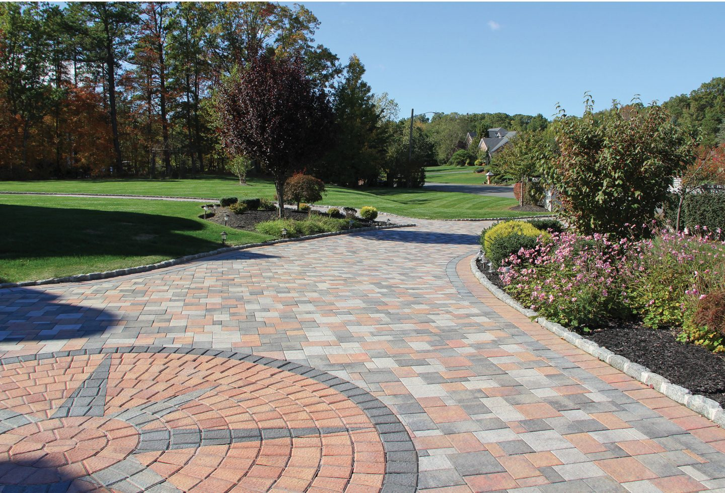 Nicolock-Outdoor-Patio-Pavers-with-Design-on-Driveway