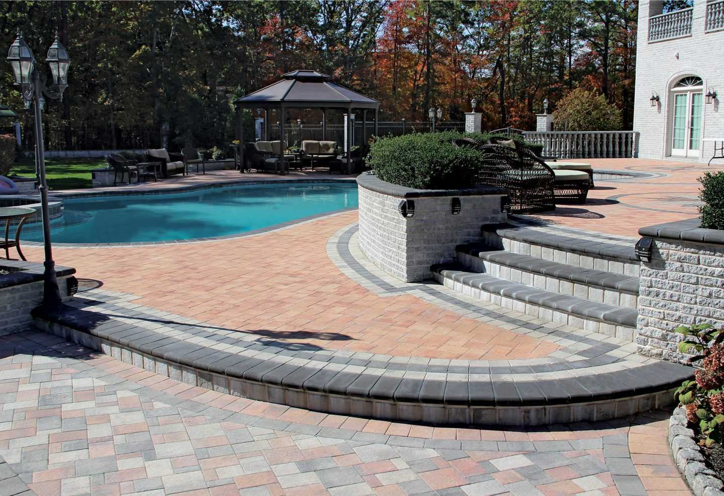 Paver-Block-Patio-near-Pool-with-Retaining-Wall-and-Stairs