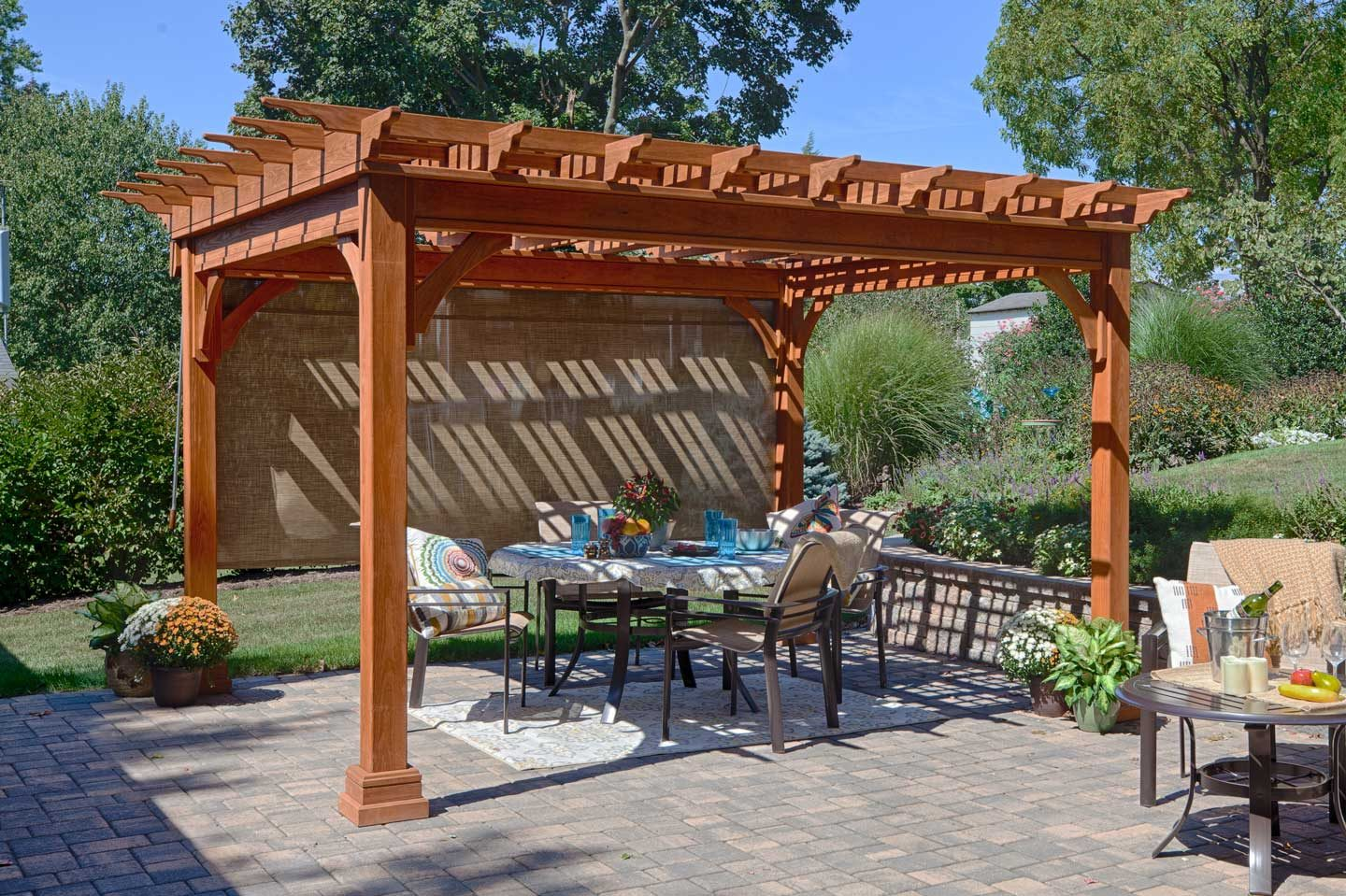 traditional wooden pergola with ez shade side curtain