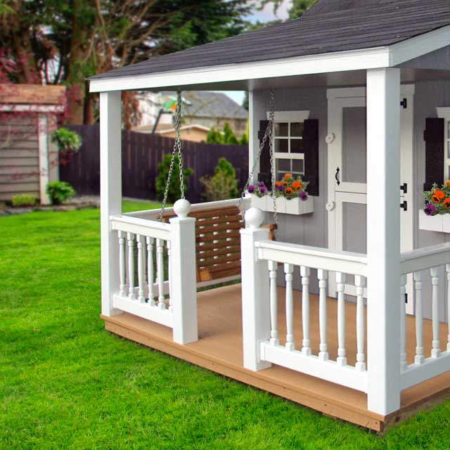 kids outdoor playhouse with a porch swing