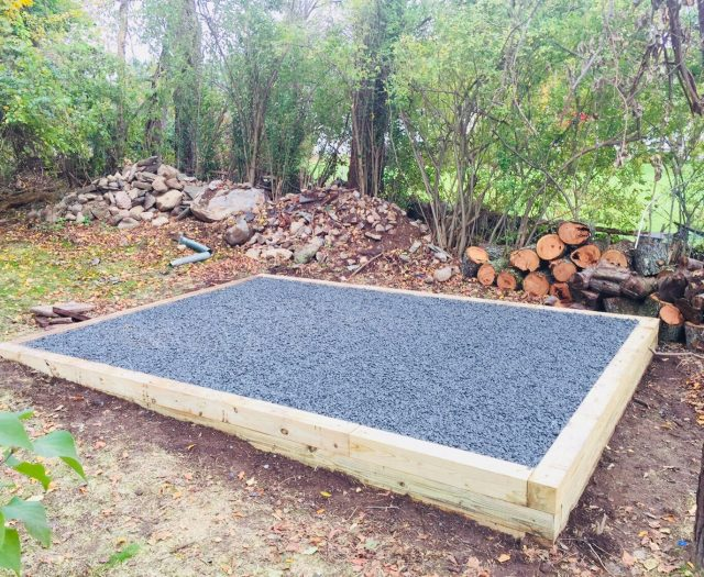 Completed Gravel Pad Installated in Backyard on Slope