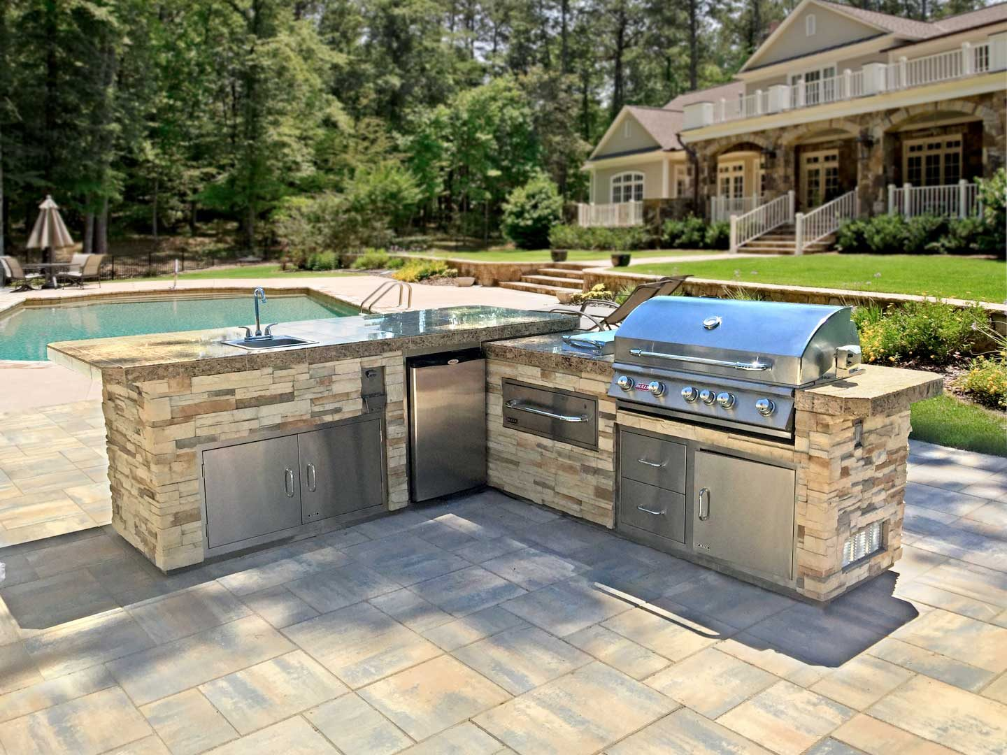 Custom-Outdoor-Kitchen-Island-with-Granite-Countertop-on-Patio