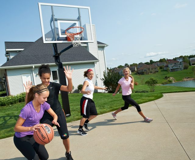Group of Girls Playing Basketball Outside Having Fun