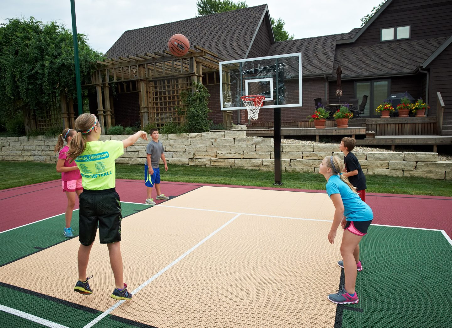 https://www.bestinbackyards.com/wp-content/uploads/2018/05/Kids-Playing-Basketball-Outside-with-Goalsetter-Hoop-1440x1044.jpg