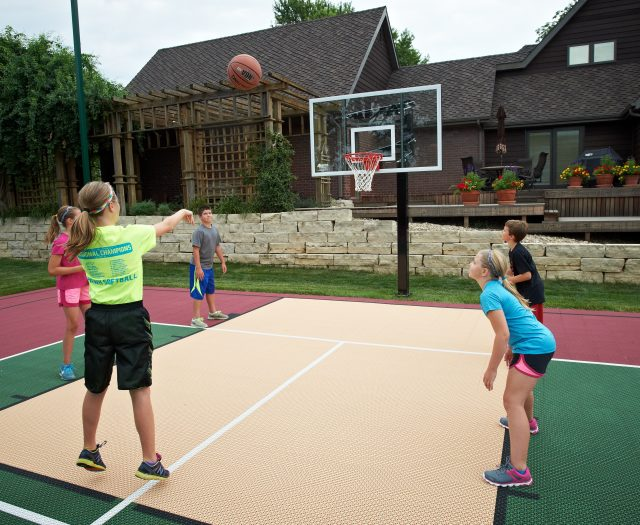 Kids Playing Basketball Outside with Goalsetter Hoop