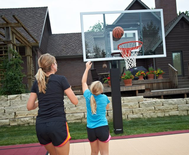 Mom and Daughter Shooting Hoops Goalsetter Basketball