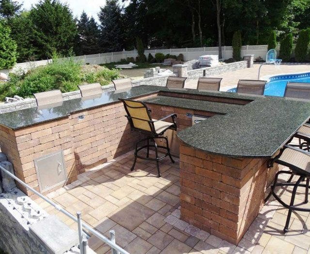 Outdoor-Kitchen-Island-Custom-Built-with-Granite-Slab-Counter