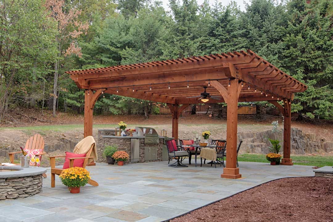 https://www.bestinbackyards.com/wp-content/uploads/2018/06/18x22-Kingston-Pergola-in-Canyon-Brown-Stain-on-a-Patio-Outdoor-Living-Room.jpg