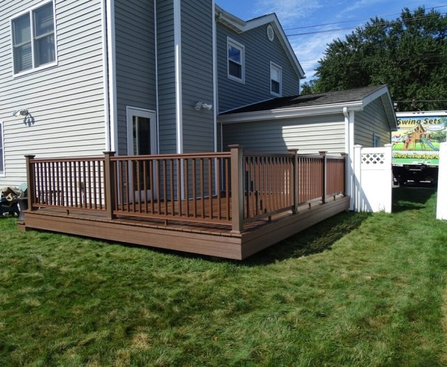 2-After-Photos-of-Beautiful-Wooden-Deck-with-Railings-and-Vinyl-Skirting