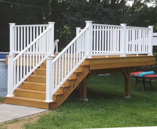 After-Photo-New-Wooden-Pool-Deck-Stained-with-Stairs-and-Railings