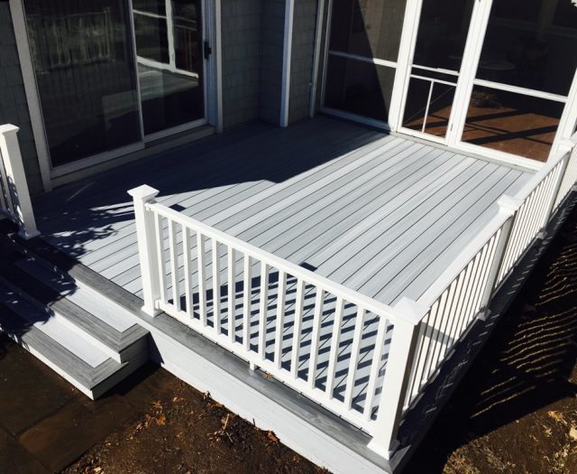 new composite deck with white vinyl railings