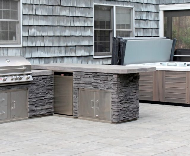Beautiful Outdoor Kitchen Island and Hot Tub on Patio