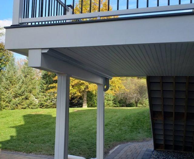 composite deck with rain escape and vinyl soffit finish