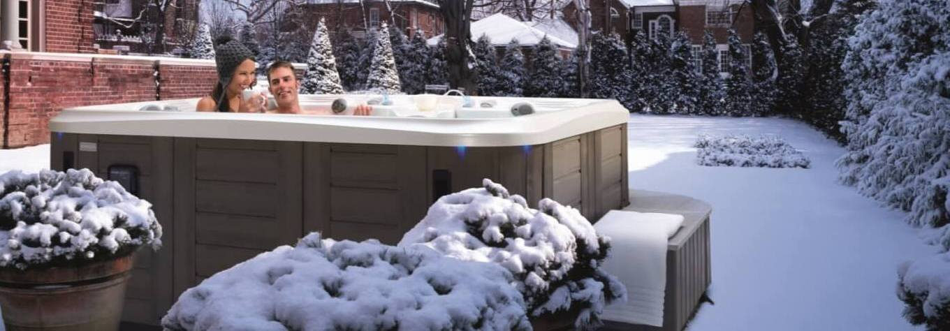Couple Relaxing in Marquis Hot Tub in Winter Snow