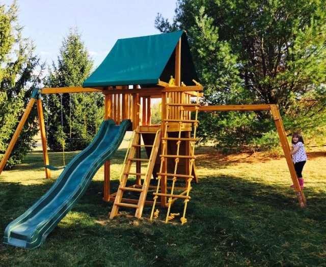 Dream Cedar Backyard Playset with Girl on Monkey Bars