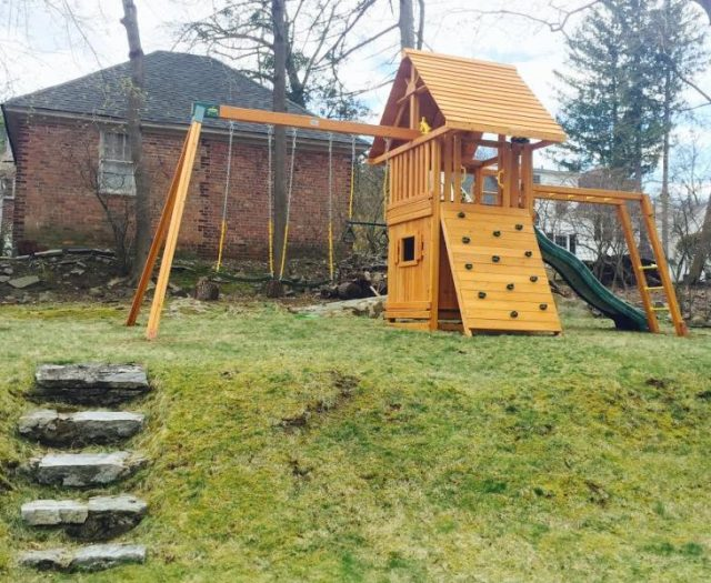 Dream Cedar Swing Set Installed on Hill with Wood Roof