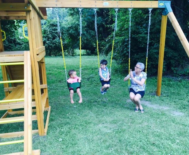 Dreamscape Cedar Swing Set with Swinging Family