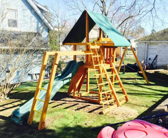 Dreamscape Outdoor Swing Set Installed in Small Backyard
