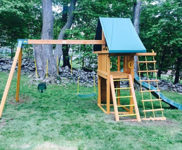 Dreamscape Outdoor Swing Set Installed on Sloped Backyard