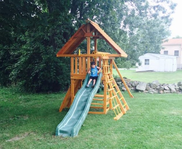 Dreamscape Swing Set with Happy Customer